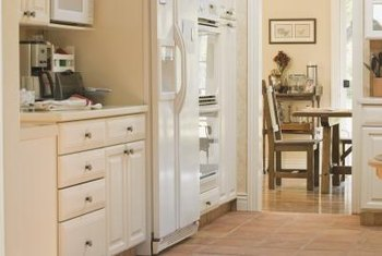 Modern maple or light wood kitchen cabinets can be painted antique white to change the over all vibe of the room.