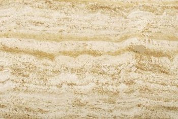 Buff travertine the same way you would marble flooring.