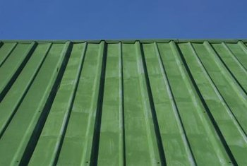 Tin roofing keeps wood and other stored items dry.