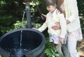 A rustic bubbler fountain may attract birds and butterflies.