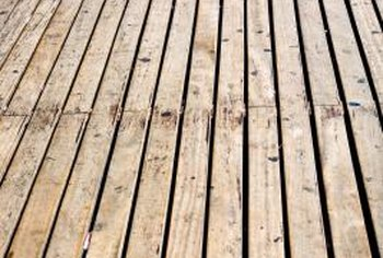 Cleaning and staining a weathered deck extends its life.