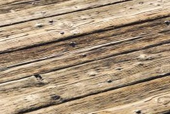 Pine resin can be removed from a deck with oil soap and a scrub brush.