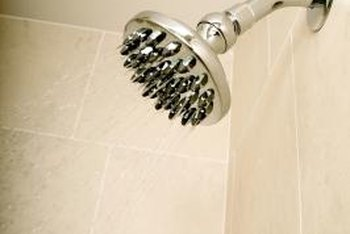 Deluxe shower heads often have nozzles to create a more soothing spray.