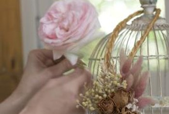 Add color to your bird cage by attaching flowers.