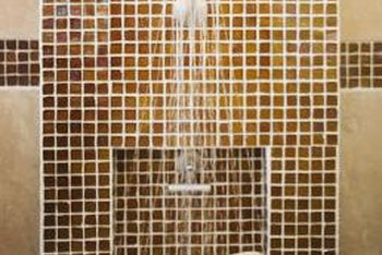 Accent a shower wall with small mosaic tiles and a built-in niche.