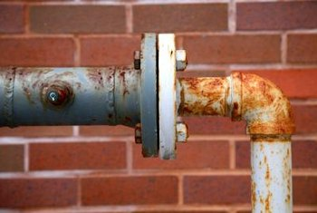 Rust is a sign of leaks at pool pipes and pumps.
