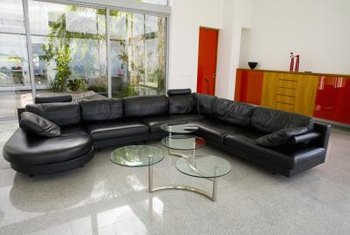 Make A Contemporary Statement With A Black Leather Sofa.
