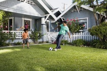 A well-maintained lawn of Bemuda grass creates a place to play.