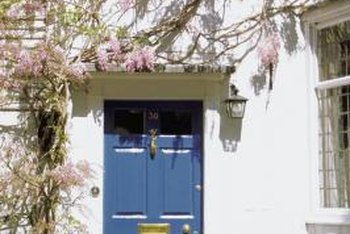 A blue door commands attention against an all-white exterior.