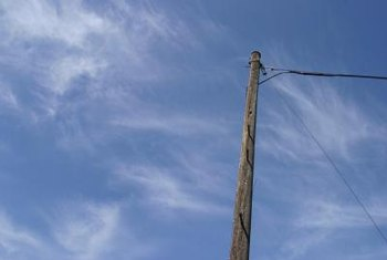 Guy wires can run from the middle or even the top of a utility pole.
