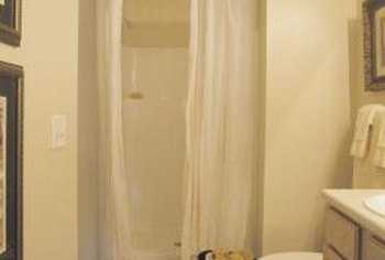 Brighten up plain shower curtains with paint or embellishments.
