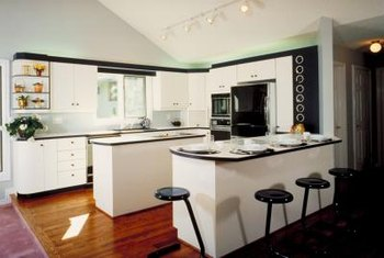 kitchen designs with black appliances. Decorating Around Black Appliances  A black and white color scheme has a contrasting fresh appeal Home Guides SF Gate