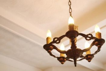 Swap the ceiling fixture for a medieval-inspired chandelier with electric candles.
