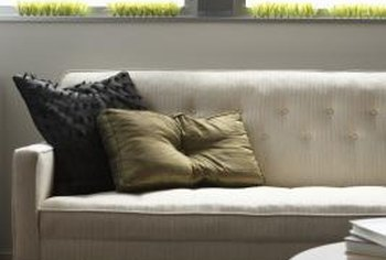 A rug and table in front of a couch near a window create a secondary focal point.