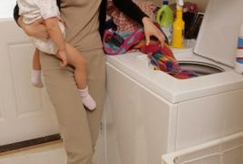 The fuse on a top-loading washing machine is part of the lid's safety mechanism.