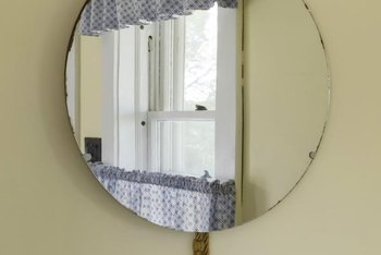 Dress up a plain mirror with cut mirror or glass pieces to emulate the look of a Venetian mirror.