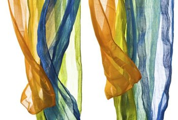 Colorful scarves become an elegant or eclectic window covering when sewn together.