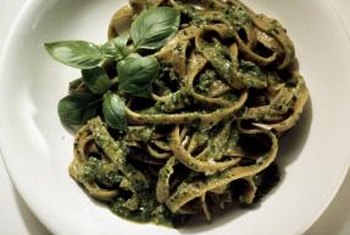 Top whole-wheat pasta with pesto for a delicious dinner.