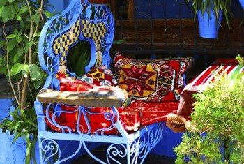 Container plants and colorful, ethnic textiles give your patio an exotic, Moroccan feel.
