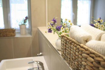 Swap out the towels for seashells for a decorative basket filler.