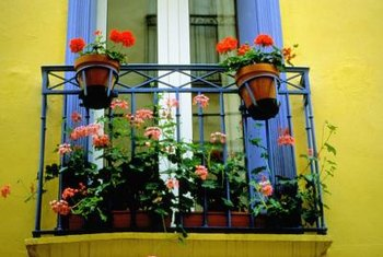 Flower boxes add a touch of scent and color to a balcony.