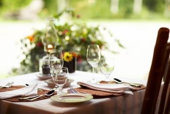 An Informal Table Setting Complements A Simple Floral Centerpiece.