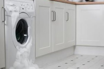 kenmore washing machine. suds may leak from your kenmore front-loader if you don\u0027t use the washing machine