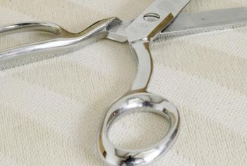 Scissor handles consist of a thumb ring and finger ring.