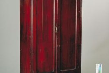 Apply translucent red varnish to a black armoire for a faux Chinese lacquer finish.