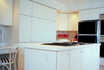 Using your white cabinets as part of a mostly monochromatic design can give your kitchen a stark, modern look.