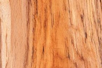 Glaze and a faux finishing tool create a wood-grain effect.
