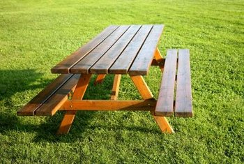 Simple wooden picnic tables can become a work of art with a bit of planning.