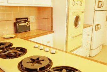 Kitchens transitioned from muted tones in the 1930s to brighter colors in the 1950s.