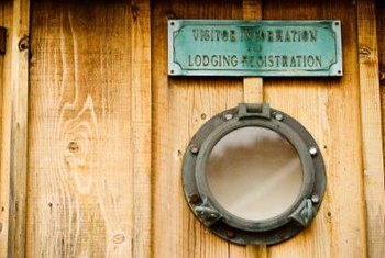 A porthole fitted with light adds a nautical edge to any room.