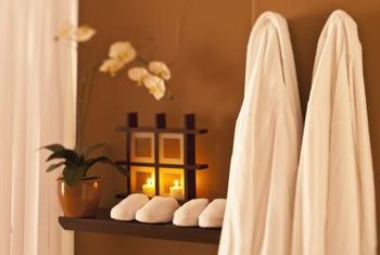Soft fragrant candles and a wall rack to hang your terry cotton robe evoke a spa-like atmosphere.