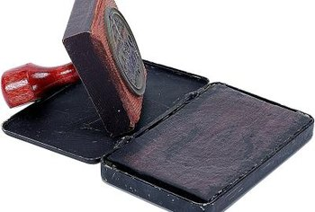 Rubber stamps provide the designs on stamped tile coasters.
