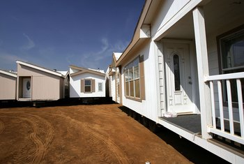 True mortgages are available for mobile homes permanently affixed to land.