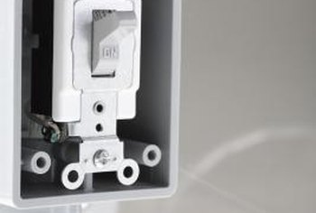Standard switches have two evenly-spaced holes for the cover plate.