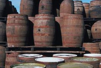 Whiskey barrels serve a second purpose when they are made into a fountain.