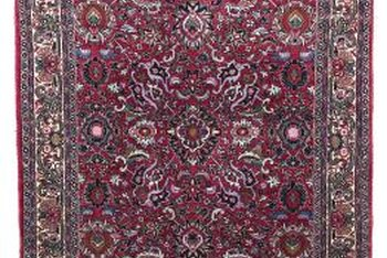 Decorate around a red Persian rug using minimalist furnishings.