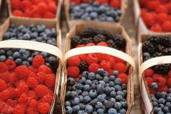 Blueberries and raspberries can be grown in the same garden but not the same planting beds.