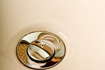 A stopper in its lowered position should not allow water to drain when the sink is full.