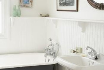 Beadboard walls fit a cottage-style bathroom.