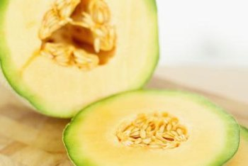 Save seeds from your garden cantaloupes for next year's planting.
