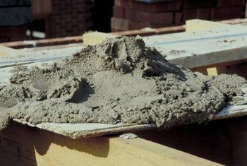 Mix cement with sand and peat moss to create a homemade artificial rock.