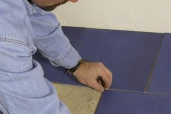 Careful alignment of vinyl floor tiles helps to maintain a square floor.
