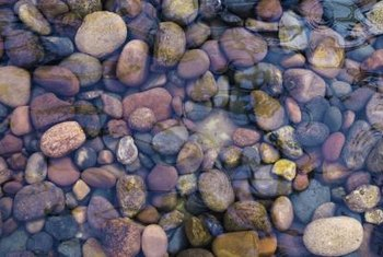 Use river rocks in the base of water features or to recreate streams.