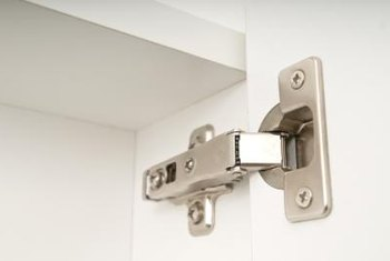 Kitchen Cabinets Hinges how to install hidden hinges on kitchen cabinets | home guides