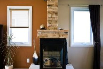 Faux stone adds natural warmth to an open room with a two-sided fireplace.