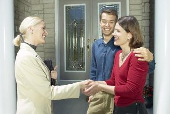 A real estate manager shows homes to potential tenants and explains the lease.